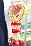Garland of jasmine flower on hand. Royalty Free Stock Photography