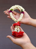 Garland of jasmine flower on hand Stock Image