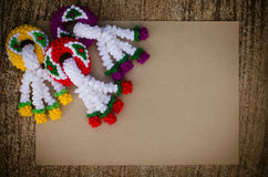 Garland knitting and brown paper Royalty Free Stock Photo
