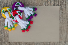 Garland knitting and brown paper Stock Photography