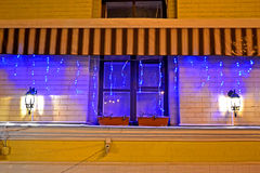 Garland lamp light with illumination on window, holiday, Royalty Free Stock Image