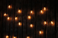 A garland of lamps. Hanging on the wall Stock Photography