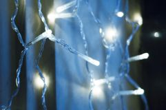 Garland of light. Blue blur lights in night city stock images