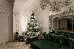 Garland light bulbs. Christmas evening. classic luxurious apartments with decorated christmas tree. Living hall large. Christmas evening. classic luxurious stock images