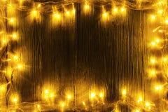 Garland Lights Frame Wood, bordo di legno, luce gialla di festa Fotografie Stock