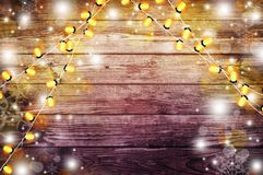 Garland with lights. Old wooden background. Celebratory lights. Stock Photography