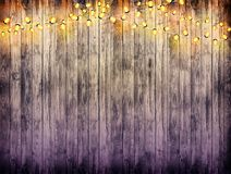 Garland with lights. Old wooden background. Celebratory lights. Night party. Royalty Free Stock Image