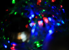 Garland lights. In the reflection of the ball Stock Images