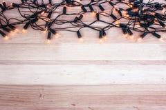 Garland Lights On Wooden Floor photos stock