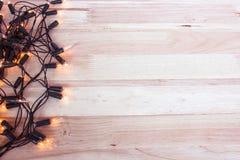 Garland Lights On Wooden Floor photographie stock libre de droits