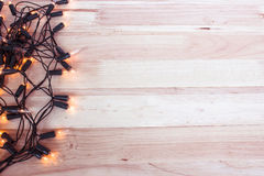 Garland Lights On Wooden Floor Royalty Free Stock Photography