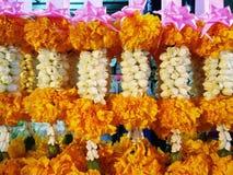 Garland. Of marigold, jasmin, crown flower with pink ribbon Royalty Free Stock Photo