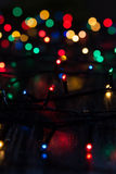 Garland of Multi-colored lights. Blur. Background. Vertical frame Royalty Free Stock Image