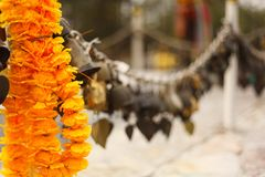 The garland is near the bells. stock images