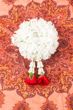 Garland on orange cloth. White garland on orange cloth is the meaning of welcome in Thailand Royalty Free Stock Photo