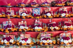 Garland from orange and white flowers. In the basket at street market near temple in Haridwar, India 8 January 2018 Royalty Free Stock Images