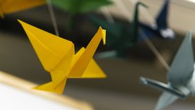 Garland of  origami bird stork stock photography