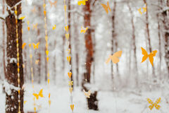 Garland of paper butterflies. Against the background of a snow-covered forest royalty free stock images