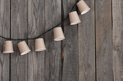 Garland of paper cups Stock Images