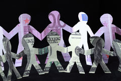Garland of paper men, dollars and euros Stock Images