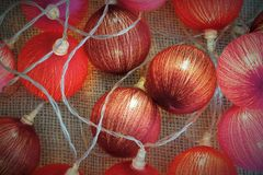 Garland of red balls. With lights Royalty Free Stock Photo