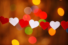 Garland with Red and white hearts  on boke Stock Photos