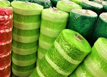 Garland Rolls in Christmas Colors. Shelved rolls of Christmas garland and gauze in red, teal, and green Royalty Free Stock Images