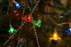 Garland shines on the tree. Christmas. Tree decorated with toys and beads to the Christmas holiday royalty free stock photos