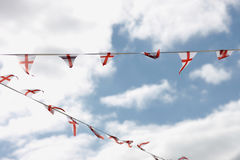 Garland of signal pennants. Against the background of a cloudy sky Stock Images