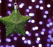 Star decor christmas decoration celebration close-up garland lights illuminated winter. Garland star green color lights illuminated decor background close-up Royalty Free Stock Image