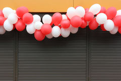 The garland of white and red balloons Royalty Free Stock Photography