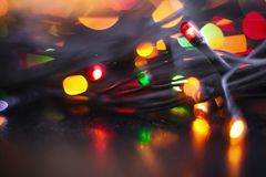 Garland with yellow red green blurred lights Royalty Free Stock Photo