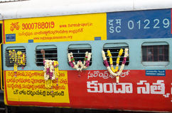 Garlanded train, India. HYDERABAD, ANDHRA PRADESH, INDIA - JANUARY 8: A railway carriage carrying Hindu priests laced with floral garlands on January 8 2013 Royalty Free Stock Photo