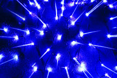 Garlands bulb lights scattering from center rays. Abstract new year garlands bulb lights and scattering from center rays background Royalty Free Stock Images