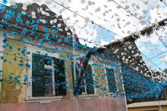 Garlands of flowers on the street of some village Stock Images