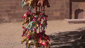 Garlands of handmade elephants hanging on sale in Rajasthan, India stock footage