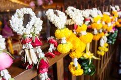 Garlands hang on wood at Wat Pho Royalty Free Stock Images