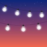 Garlands of light bulbs against night starry sky Stock Photos