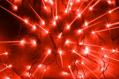 Garlands lights and scattering from center rays. Abstract new year garlands bulb lights and scattering from center rays background Royalty Free Stock Image
