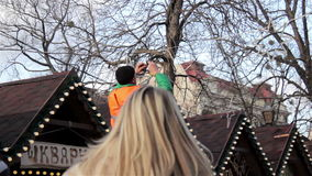 Garlands and people in the city stock footage