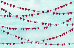 Garlands with red hearts on a blue background Stock Photo