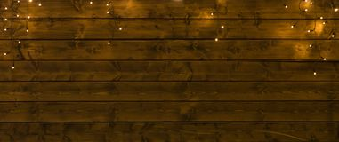 Garlands on wooden planks stock images
