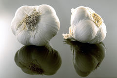 Garlic. On a black mirroring underground Stock Image