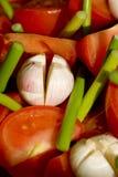 Garlic. Fresh garlic on piece of vegetables Royalty Free Stock Image