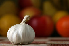 Garlic. On a kitchen table on a background of vegetables Stock Photos