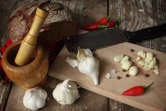 Garlic. Some garlic bulbs on kitchen table royalty free stock photo