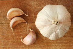 Garlic. On wood cutting board Stock Photos