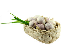 Garlic. In basket on white background Royalty Free Stock Photos