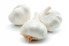 Garlic. Three cloves of garlic arranged on a white background close-up Royalty Free Stock Image