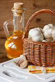 Garlic. Fresh garden garlic in a basket and olive oil royalty free stock photography